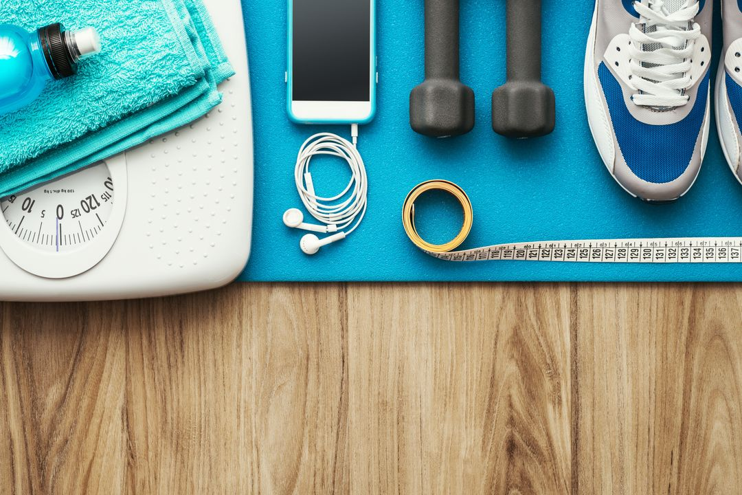Equipment used for health and fitness - Yoga mat, weight scale, mobile phone, tape measure, hand weights, running shoes